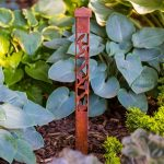 Ivy Design 2x2 Light Bollard - Weathered Steel in Garden Setting
